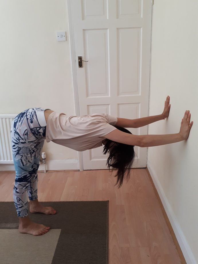 Office Yoga Downward Facing Dog Against the Wall